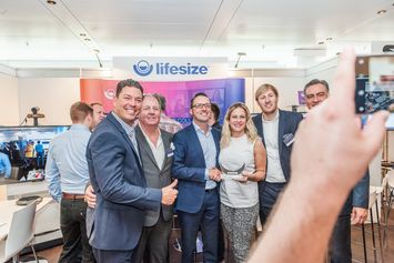 Lifesize presents award to Jorg Weisflog DEKOM at Conferencing and Seaport Day 2018