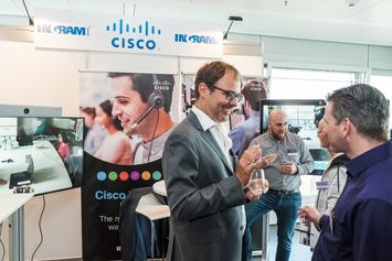 Steffen Weberruss of DEKOM in front of Cisco booth at DEKOM Conferencing & Seaport Day 2018